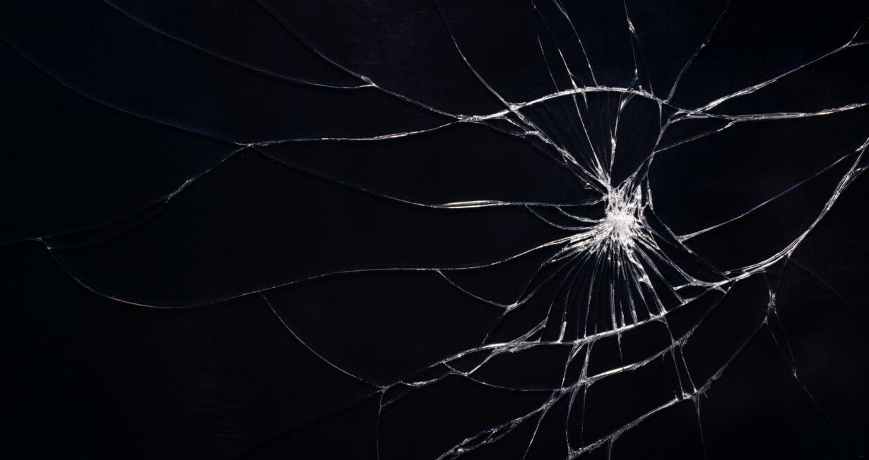 Broken glass texture with cracks.